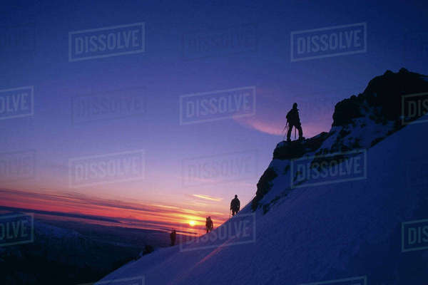 Climbers On Ridge at Sunset Chugach State Park Southcentral Alaska Winter Scenic Rights-managed stock photo