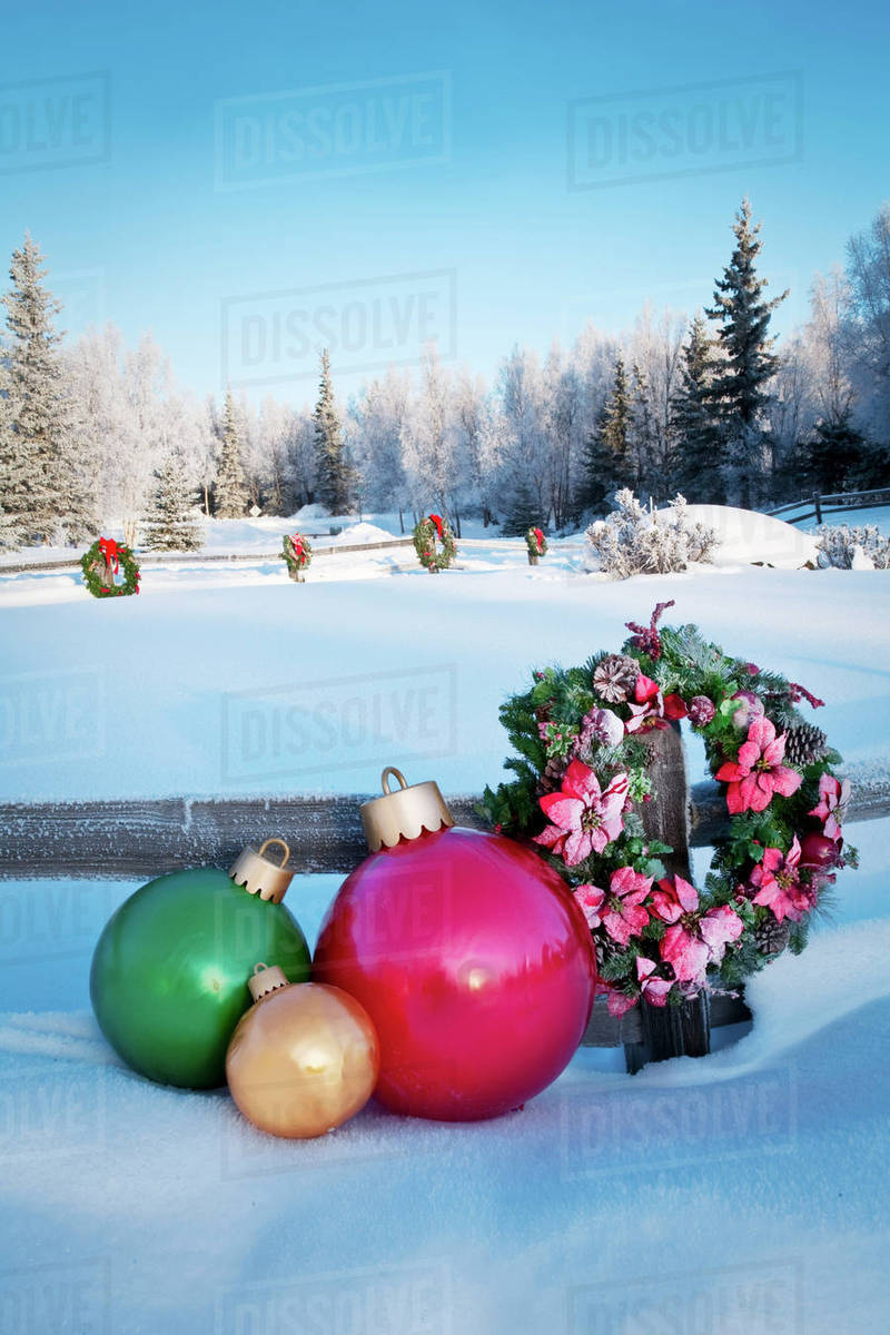 split rail fence decorated with christmas wreaths and decorations anchorage southcentral alaska