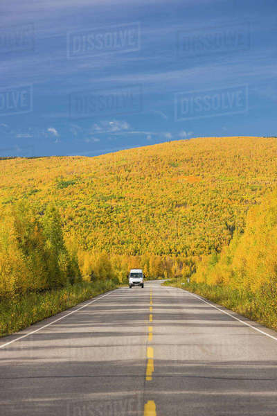 White Camper Van Traveling The Steese Highway North Of Fairbanks On A Sunny Fall Day, Fall Foliage, Fairbanks, Interior Alaska, Usa. Rights-managed stock photo