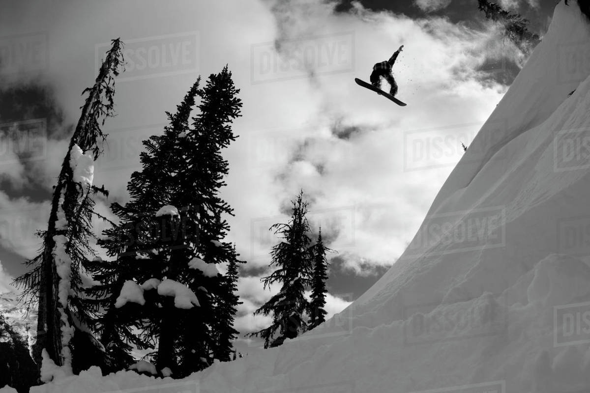 Professional snowboarder, Kevin Pearce, makes a big air jump, Canada Rights-managed stock photo