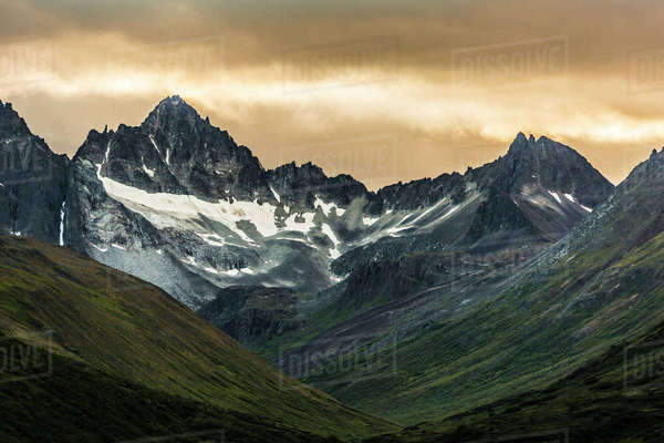 Snow on mountains in the Alaska Range, Southcentral Alaska, Summer Rights-managed stock photo