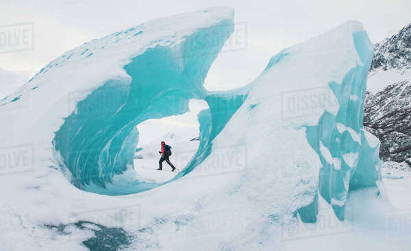 Man Skiing Near Frozen Icebergs In Winter, Knik Glacier, Southcentral Alaska, USA Rights-managed stock photo