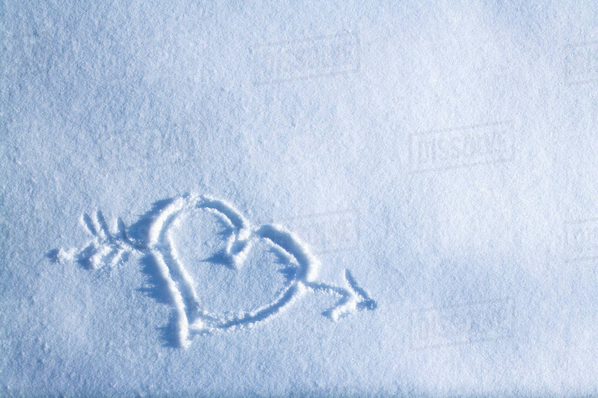 drawing of heart with arrow through it in blanket of fresh snow