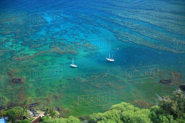 USA, Hawaii Islands, Big Island, Two scuba diving boats anchored offshore among reefs; Kohala Coast Rights-managed stock photo
