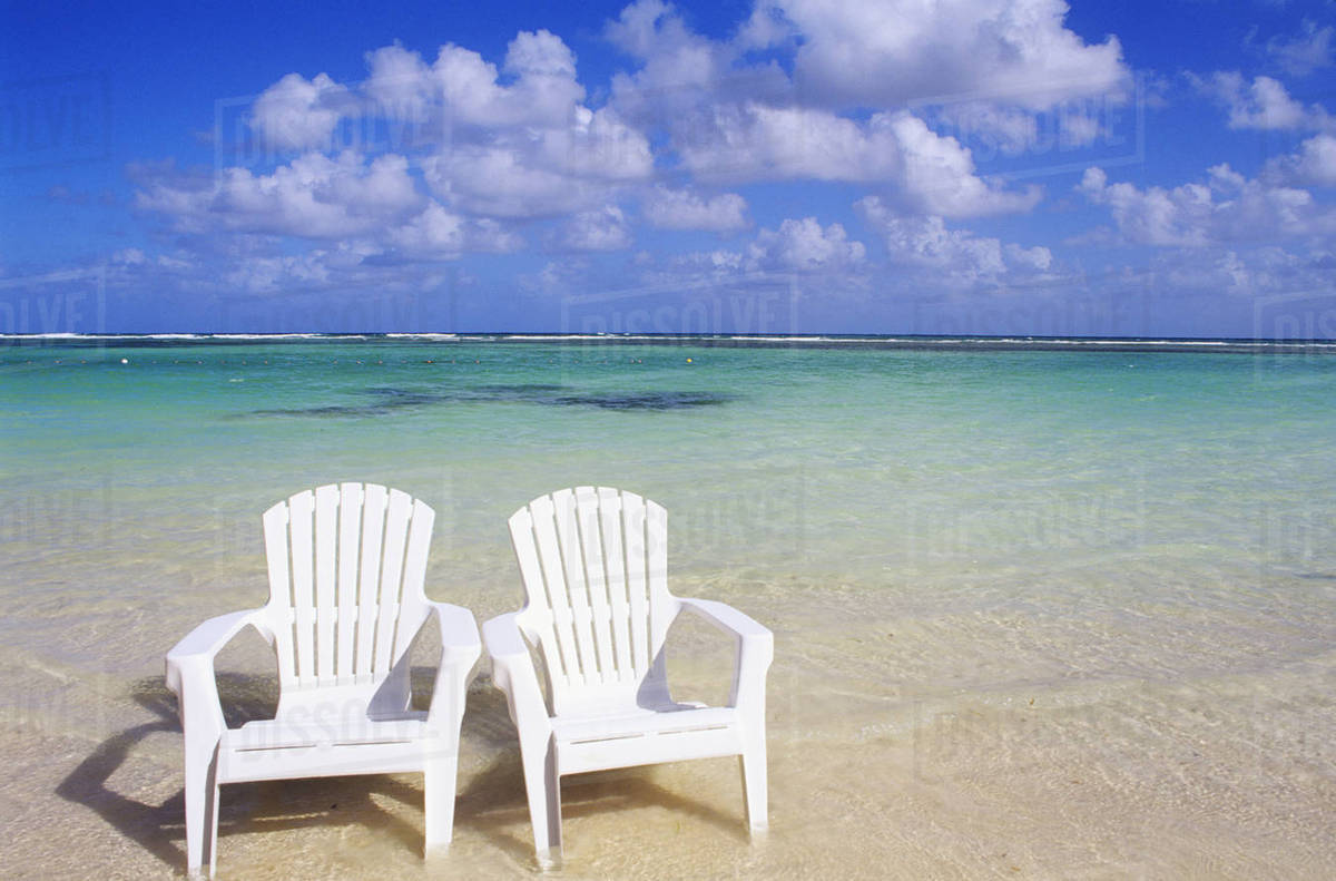 White Beach Chairs On Beautiful Clear Turquoise Water