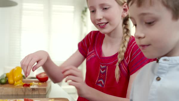 Children preparing pizza at kitchen. Royalty-free stock video