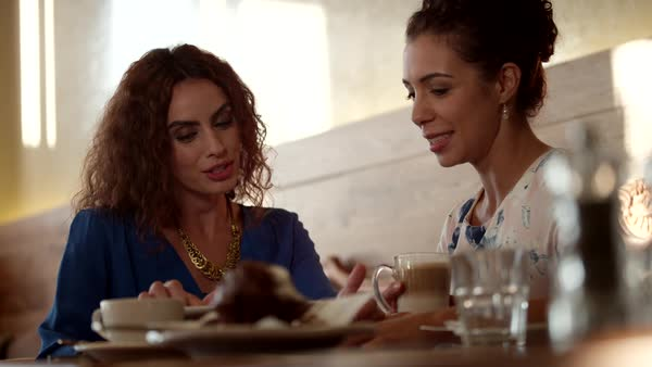 Women discussing at restaurant. Royalty-free stock video