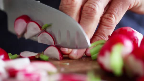 Woman cutting radishes Royalty-free stock video