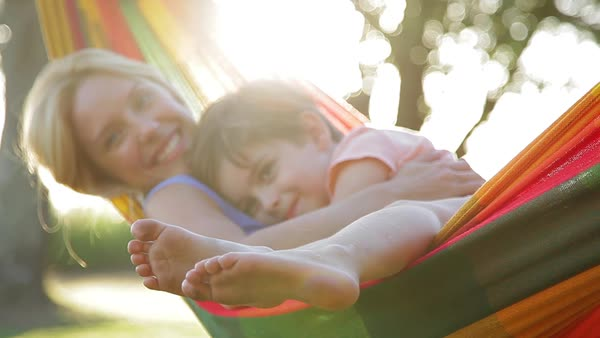 Mother and young son relaxing together in hammock Royalty-free stock video