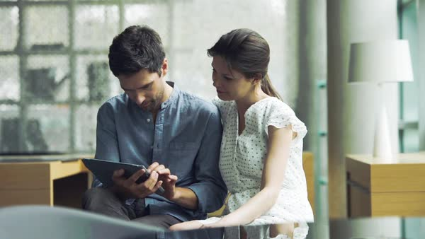 Couple sitting together using digital tablet Royalty-free stock video