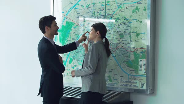 Couple looking at subway map arguing Royalty-free stock video