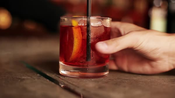 Bartender serving negroni to customer Royalty-free stock video