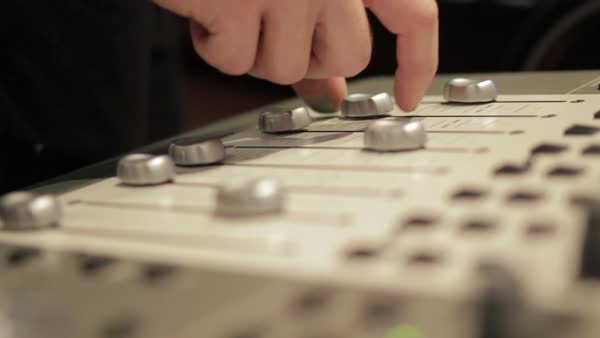 Sound engineer adjusting levels on audio mixer, close-up Royalty-free stock video