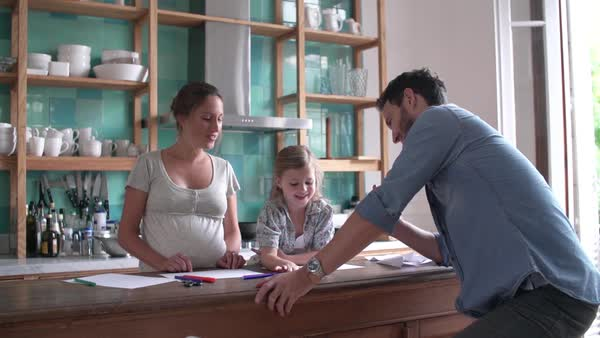 Parents coloring with young daughter in the kitchen Royalty-free stock video