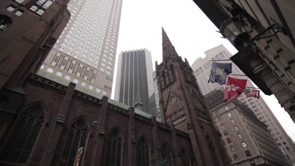 Trinity Church beneath towering high rises, New York City, New York, USA Royalty-free stock video