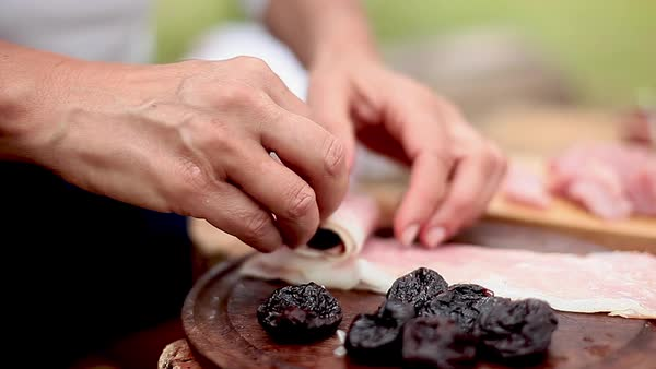 Wrapping prunes in prosciutto Royalty-free stock video