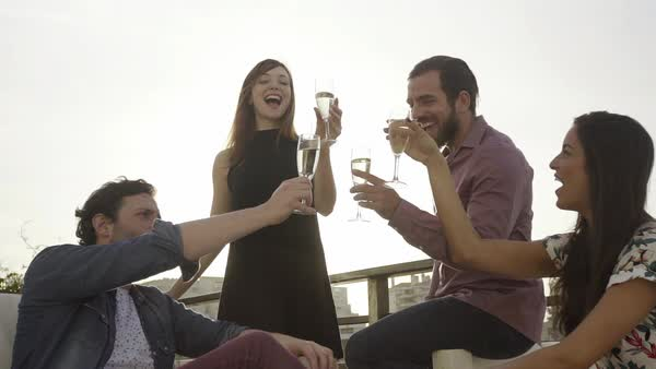 Group of friends clinking champagne glasses outdoors Royalty-free stock video