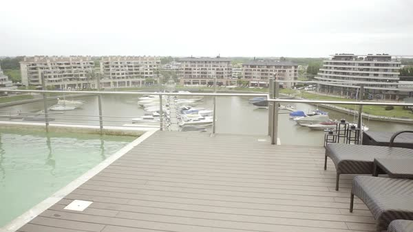 Marina viewed from rooftop pool deck at luxury hotel Royalty-free stock video