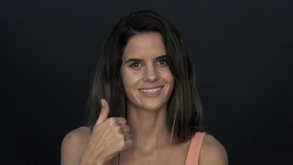 Woman giving a thumbs up portrait Royalty-free stock video