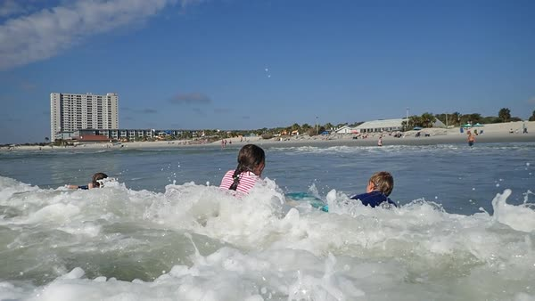 Children Bodyboarding In Ocean Waves At Myrtle Beach Royalty Free Stock Video