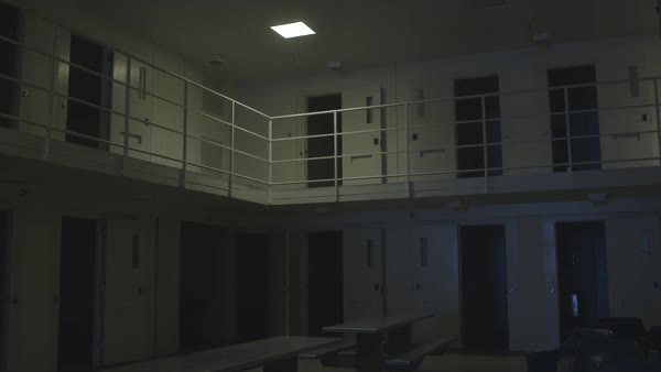 Panning shot of interior of a jail Royalty-free stock video