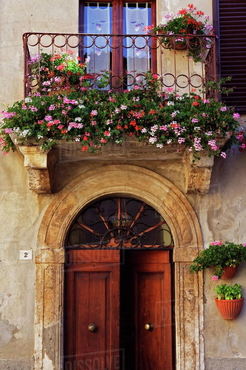 balcony flowers and doorway detail stock photo dissolve