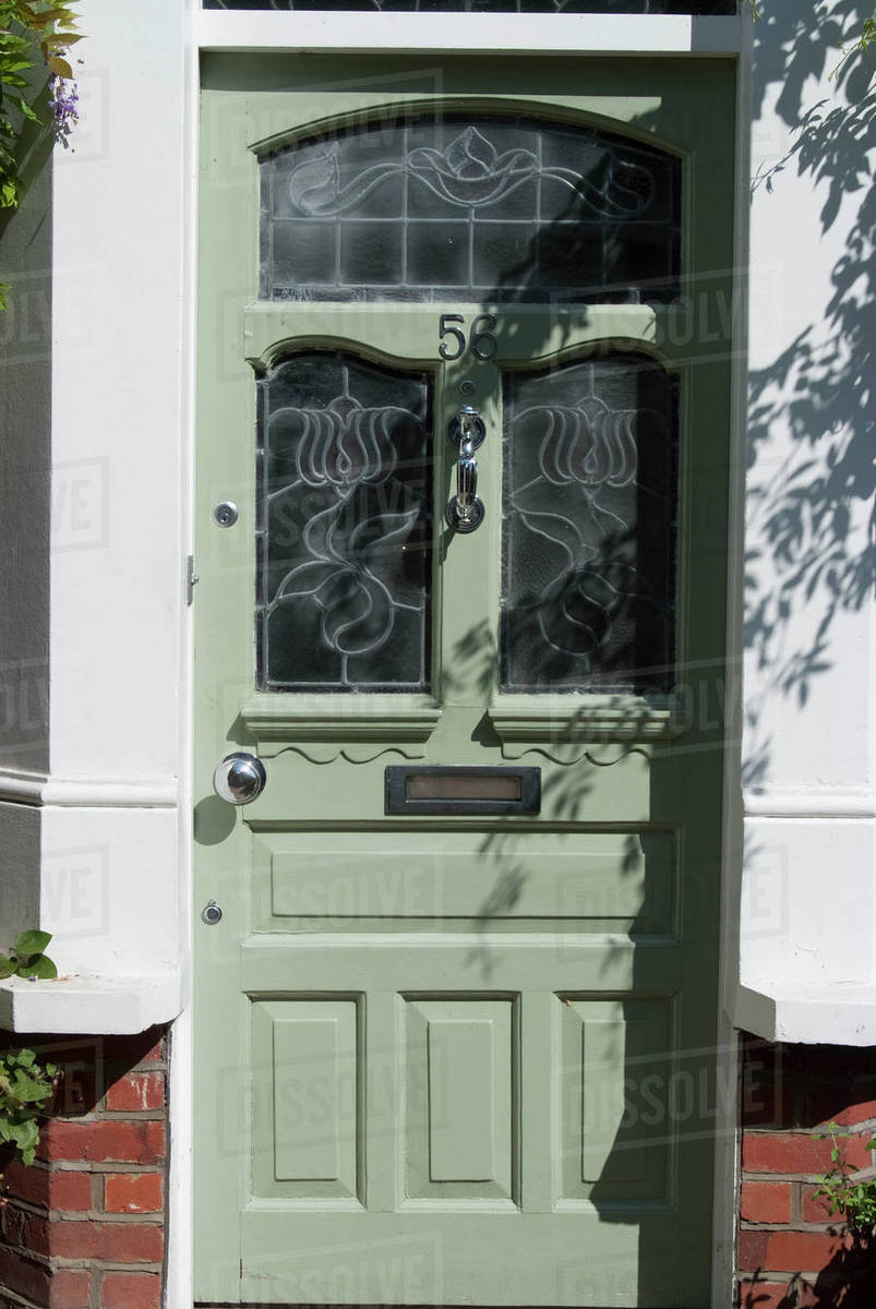 A Lime Green Gl Front Door Of Residential House