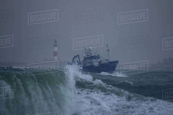 Fishing vessel 'Surmount' in rough weather approaching Peterhead Harbour, November 2014.   Rights-managed stock photo