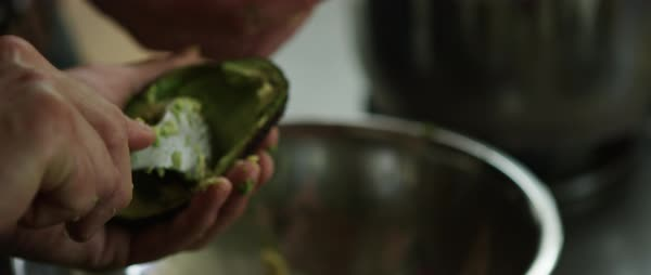 Hand-held shot of a person scooping avocado out Royalty-free stock video