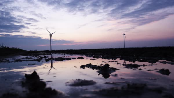 Static shot of wind turbines at dawn Royalty-free stock video