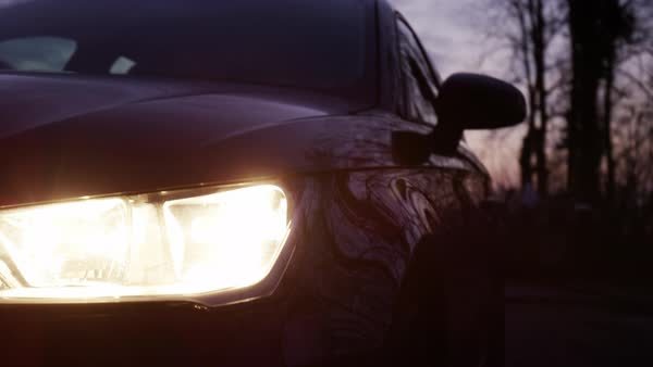 Hand-held shot of a car headlight Royalty-free stock video