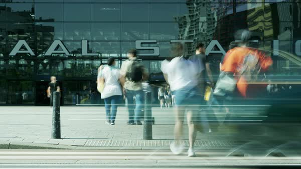 Timelapse of commuters walking in and out of Centraal railway station in Rotterdam Royalty-free stock video
