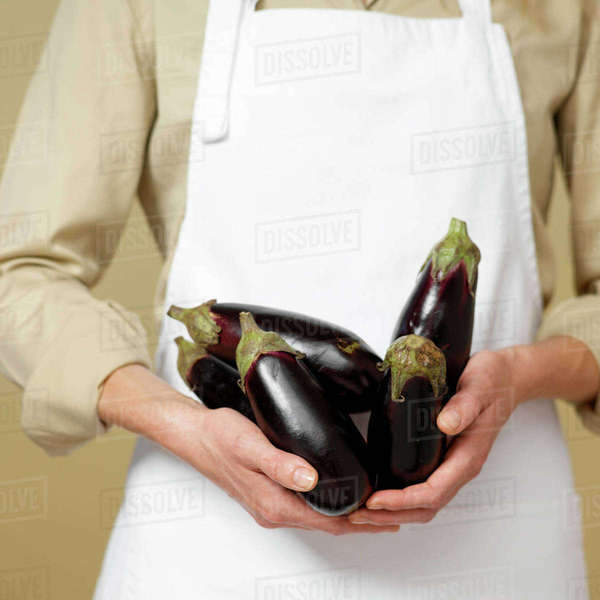 Close-up of Woman's Hands holding Eggplants Royalty-free stock photo