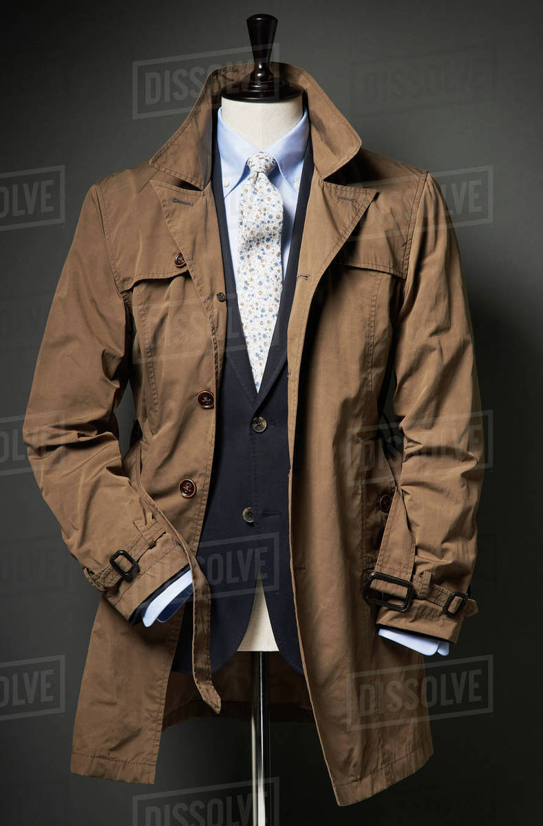 clearance best authentic official sale Brown trench coat with suit jacket, shirt and tie on a bust, studio shot  stock photo