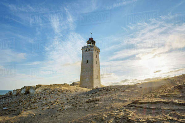 Lighthouse and Dunes Rubjerg Knude with Sun, Lokken, North Jutland, Denmark Royalty-free stock photo
