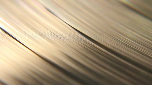 Macro shot of a vinyl sic spinning with its retro grooves Royalty-free stock video
