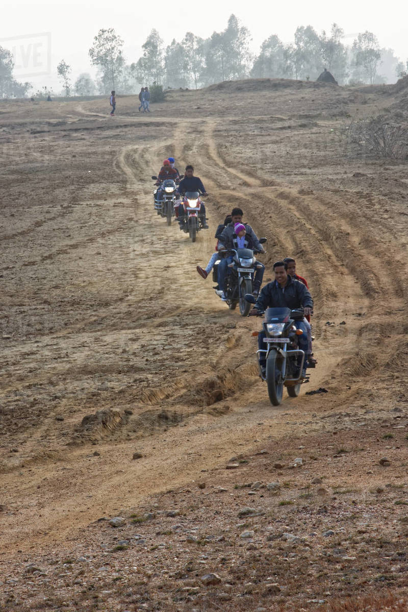Group of Indian people are driving motorcycle in a dry land Royalty-free stock photo