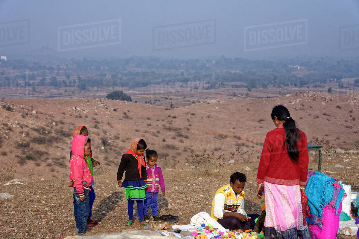 Indian family with children buying toys from a rural hilltop fair. Royalty-free stock photo