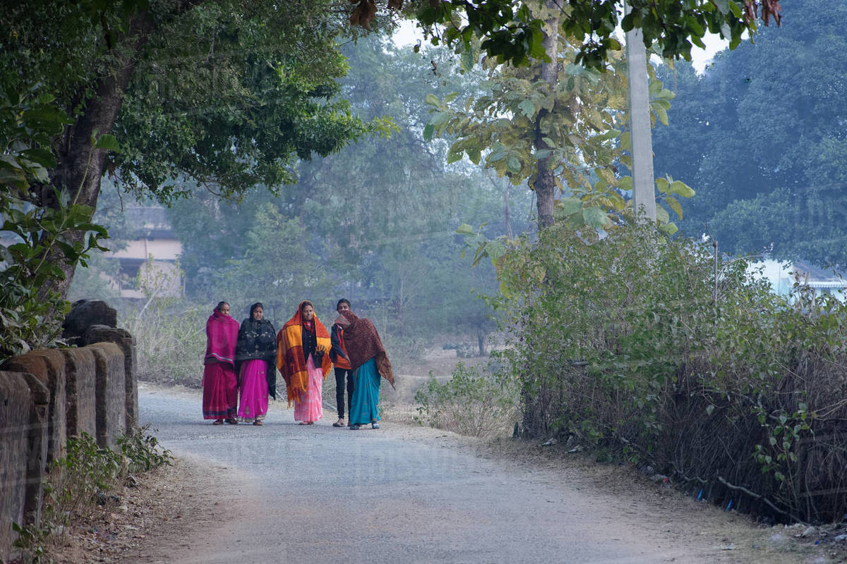 A group Indian woman are walking through rural road in winter morning Royalty-free stock photo