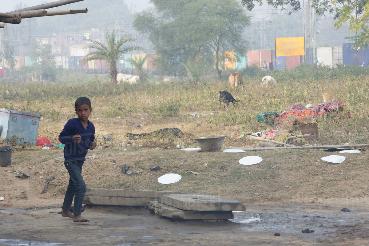 Indian street child is running on rural background Royalty-free stock photo