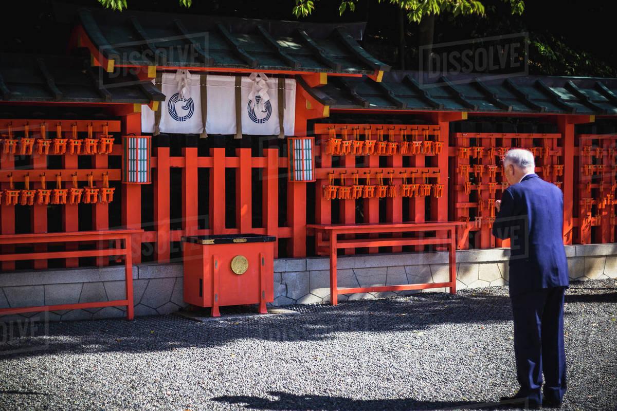 Worshipper at Fushimi Inari Shrine in Kyoto, Japan Royalty-free stock photo