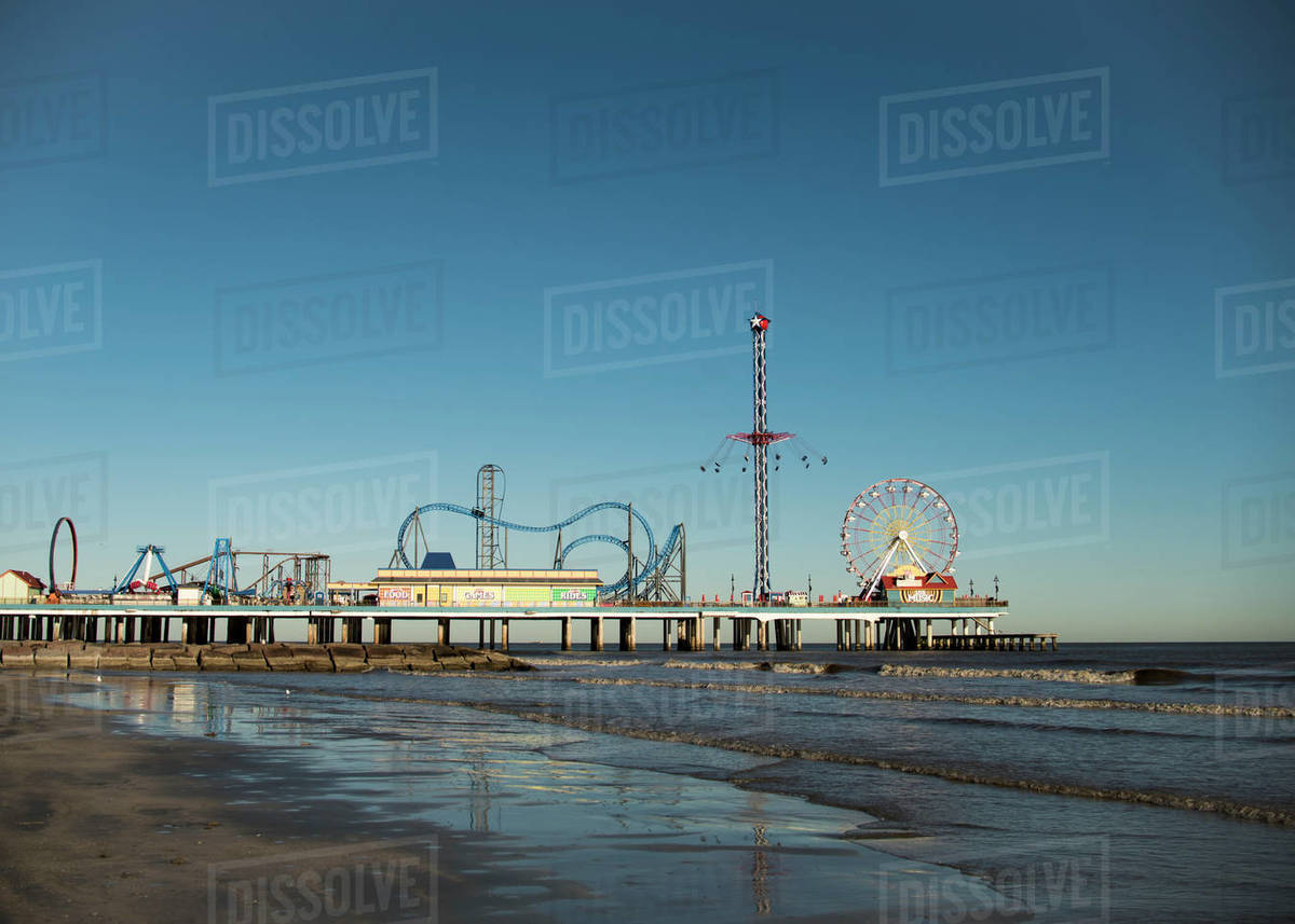 Pier with amusement park at Galveston, Texas beach. Royalty-free stock photo