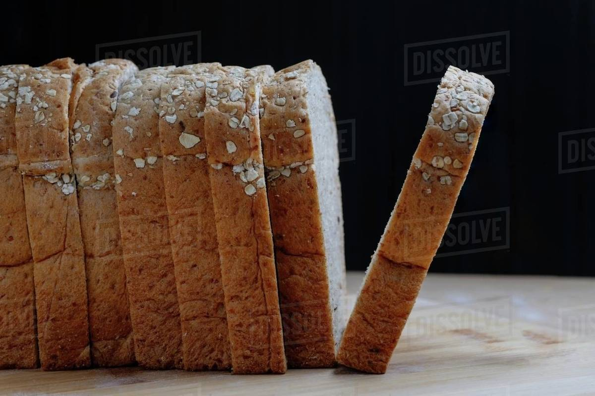 Side view of sliced whole wheat bread in a row Royalty-free stock photo