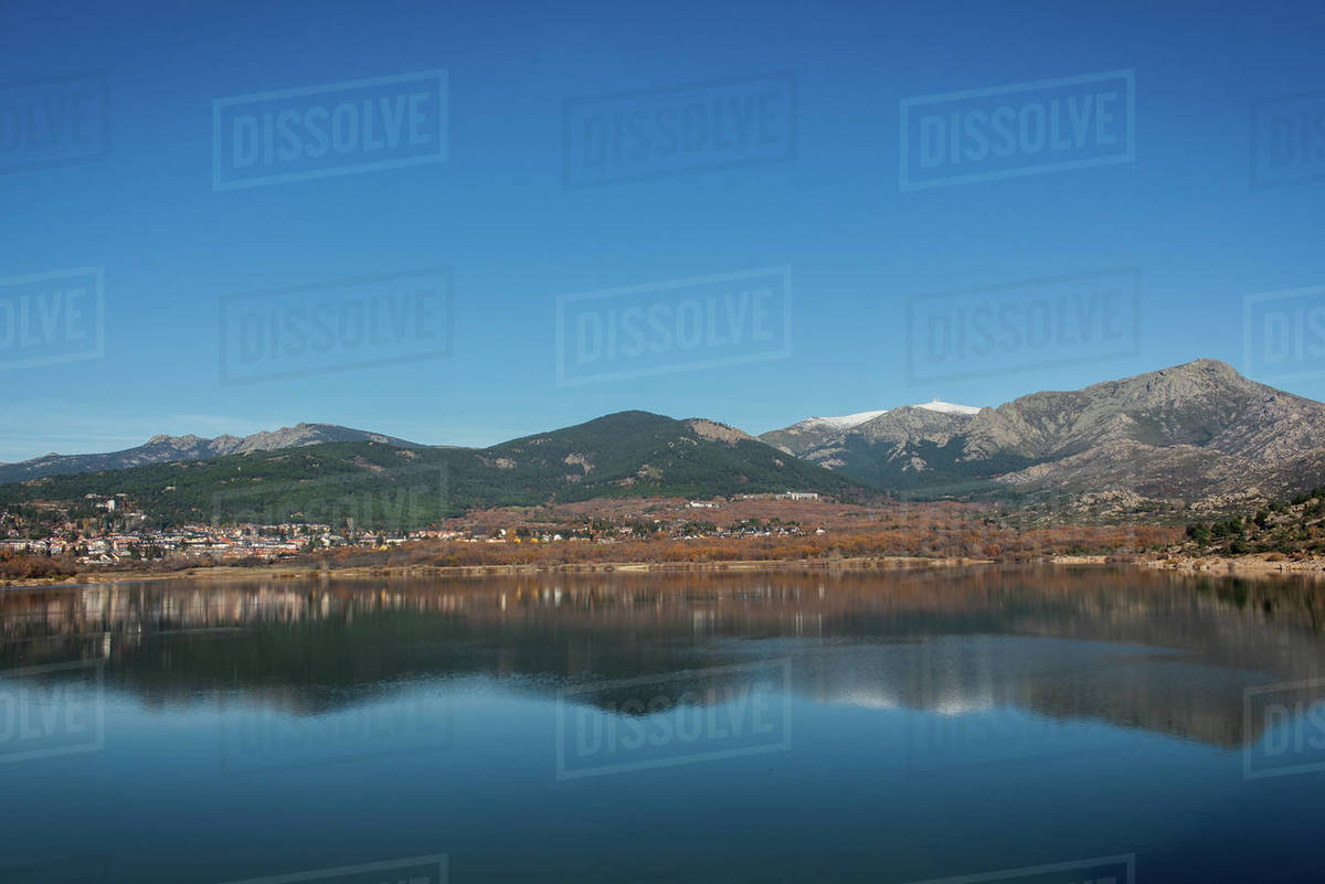 Mountains reflected on the blue water of a lake Royalty-free stock photo