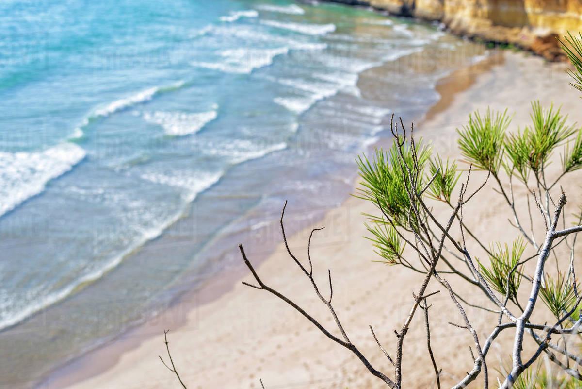 Waves breaking against headland on rocky coastline Royalty-free stock photo