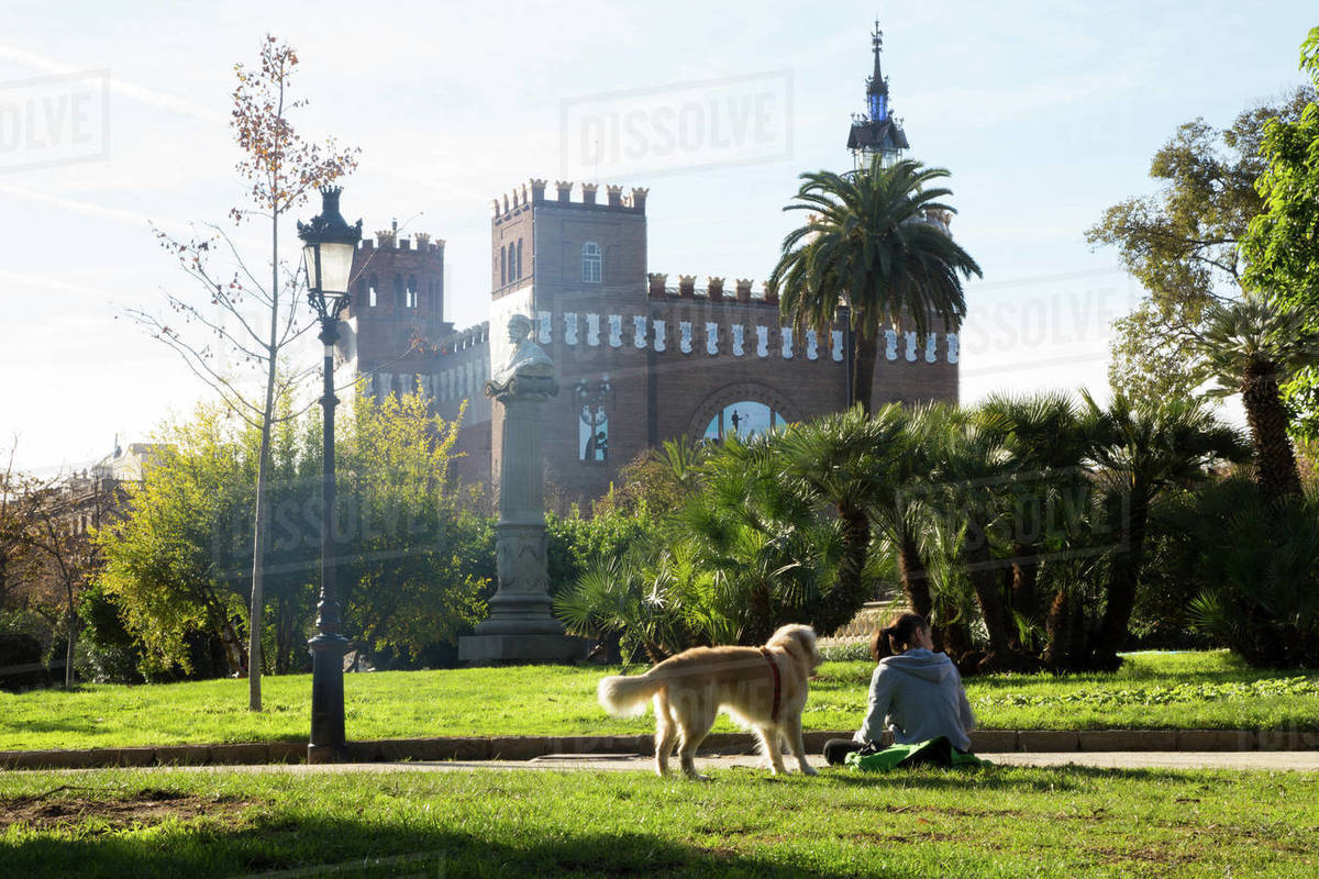 Woman with her dog in Barcelona Park Royalty-free stock photo
