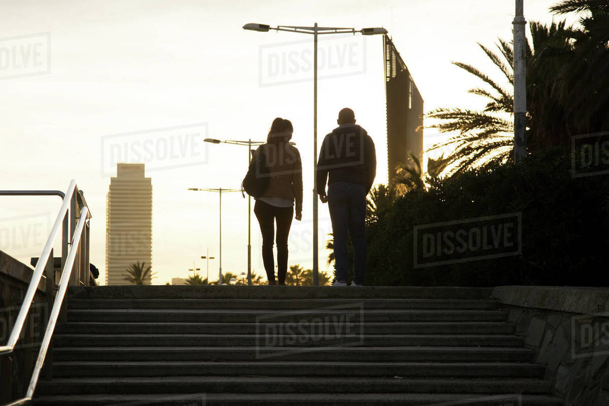Young couple walking the afternoon in Barcelona Royalty-free stock photo