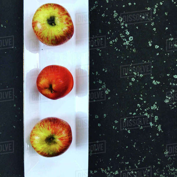 Overhead view of apples in plate on rock Royalty-free stock photo