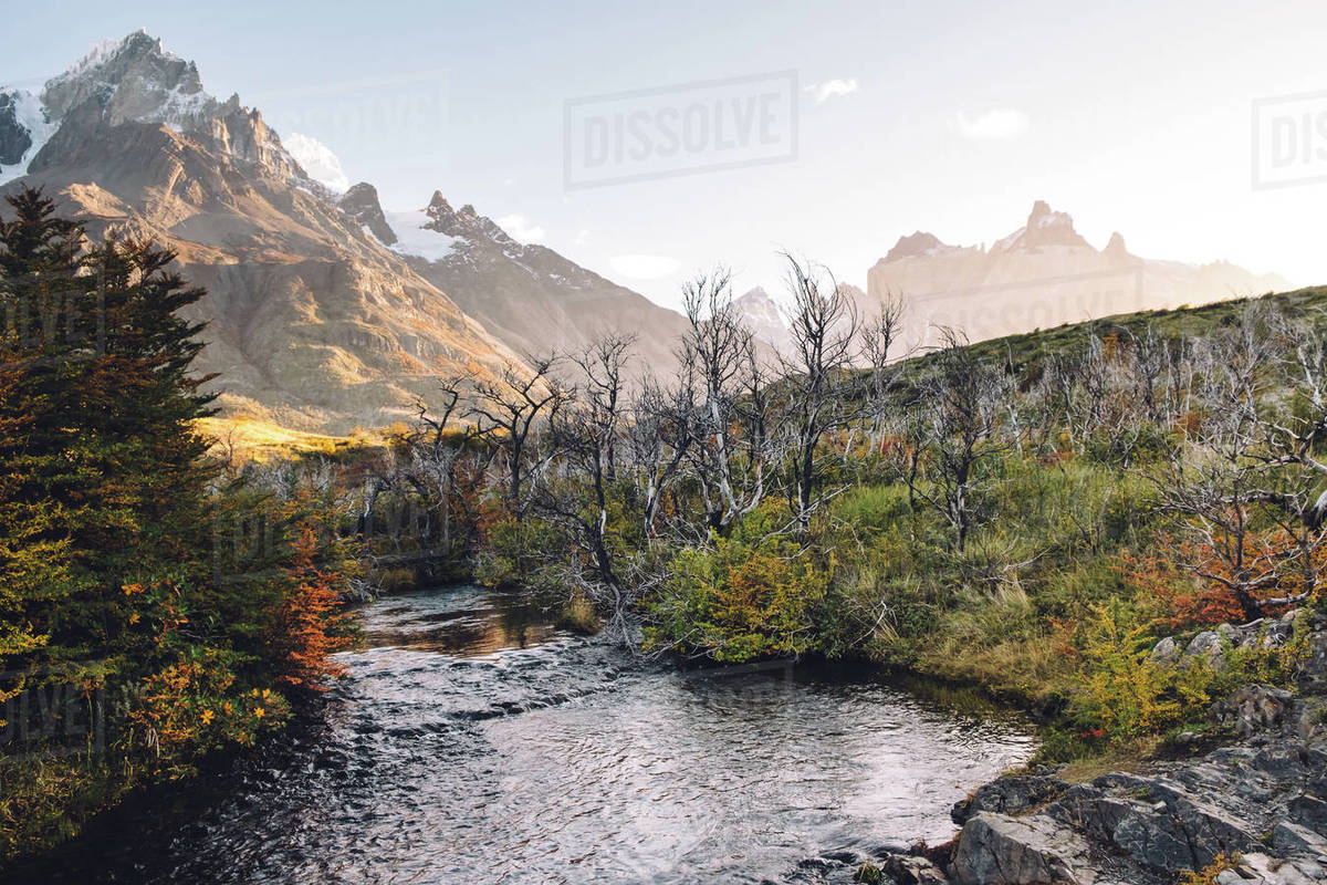 Scenic view of a river and snowy mountains in autumn Royalty-free stock photo