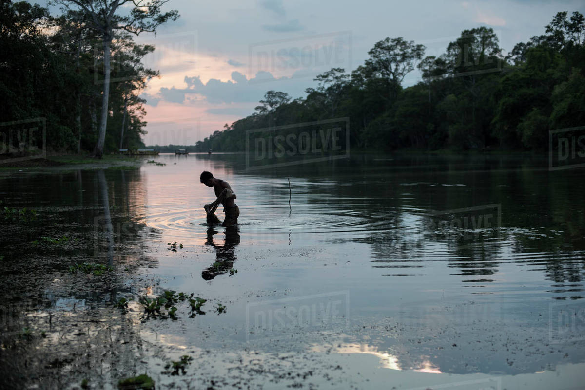 A fisherman trying to catch fish on a pond in Angkor Wat, Siem Reap, C Royalty-free stock photo